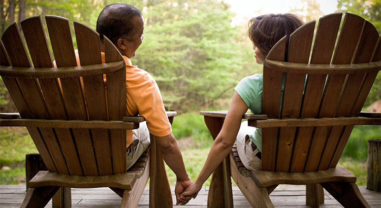 Couple on porch are downsized home